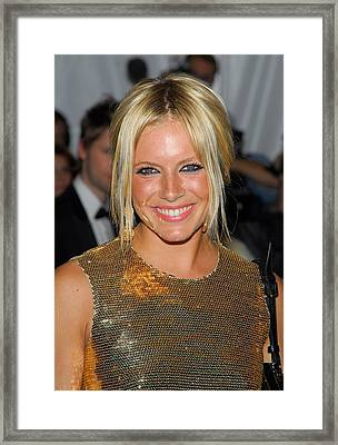 Sienna Miller Wearing Burberry Framed Print