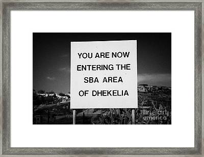 sign marking entrance of SBA Sovereign Base area of Dhekelia in the british controlled cyprus Framed Print by Joe Fox