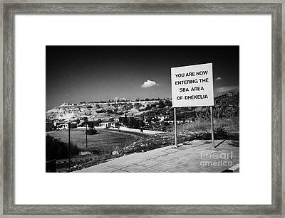 sign overlooking pyla and turkish controlled territory marking entrance of SBA Sovereign Base area Framed Print by Joe Fox