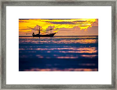 Silhouette Boat At Sea Framed Print by Arthit Somsakul