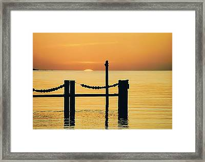 Silhouette Dock, Florida Framed Print by Lynn Koenig