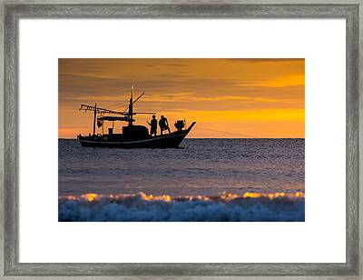 Silhouette Fisherman On Boat In Sunset Huahin Framed Print by Arthit Somsakul