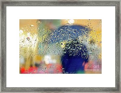Silhouette In The Rain Framed Print by Carlos Caetano