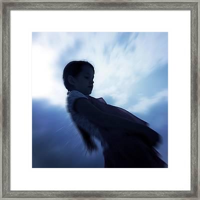 Silhouette Of A Girl Against The Sky Framed Print