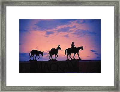 Silhouette Of Donkey Train Statue Framed Print by Corey Hochachka