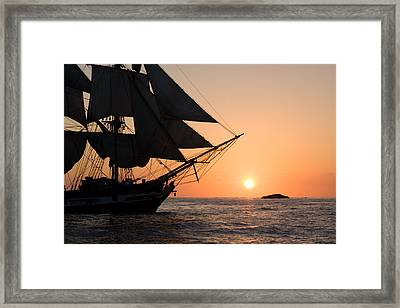 Silhouette Of Tall Ship At Sunset Framed Print