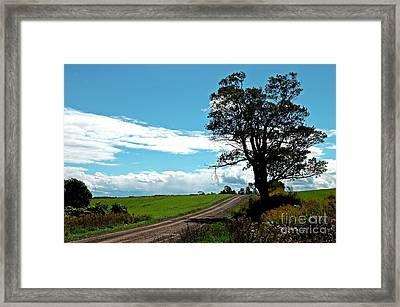 Framed Print featuring the photograph Silhouette On A Country Road by Christian Mattison