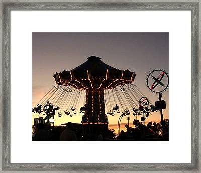 Silhouetted Amusement Ride Framed Print by Kim French