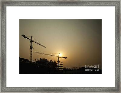 Silhouetted Construction Cranes Framed Print by Shannon Fagan