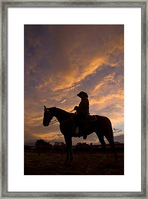 Silhouetted Cowboy Actor On Horseback Framed Print by Ralph Lee Hopkins