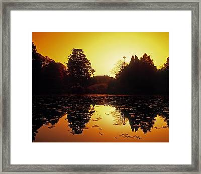 Silhouetted Home And Trees Near Water Framed Print by The Irish Image Collection