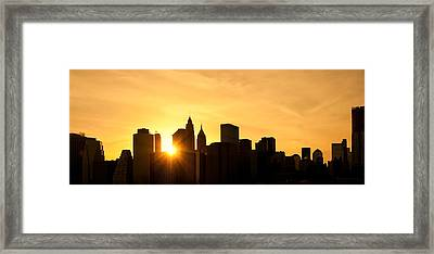 Silhouetted Manhattan  Framed Print