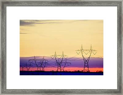 Silhouetted Transmission Towers Framed Print