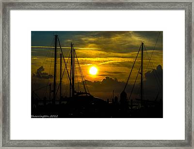 Silhouettes At The Marina Framed Print