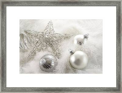 Silver Holiday Ornaments In Feathers Framed Print by Sandra Cunningham