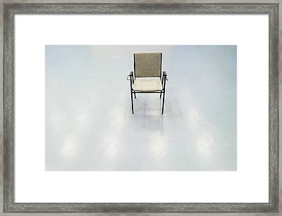 Single Chair In The Otherwise Empty Framed Print