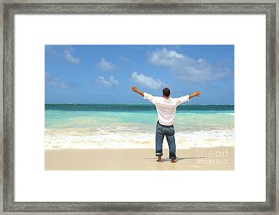 Single Male Standing On Beach Facing Ocean Open Arms Framed Print by Brian Akamine