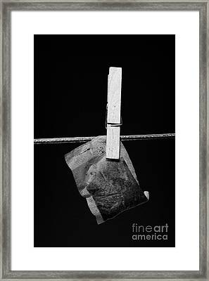 Single Wet Teabag Hanging On A Washing Line With Blue Sky Framed Print by Joe Fox