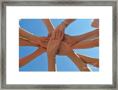 Six People Stacking Their Hands  Framed Print by Sami Sarkis