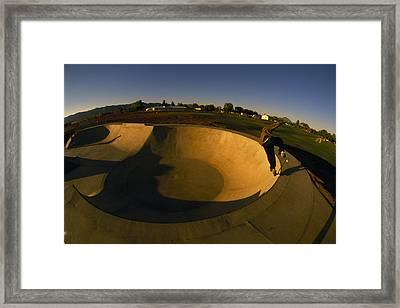 Skateboarding In A Skate Park Framed Print by Bill Hatcher