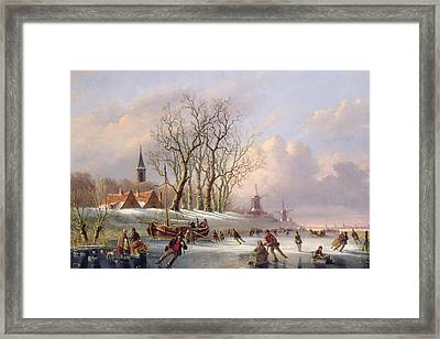 Skaters On A Frozen River Before Windmills Framed Print by Dutch School