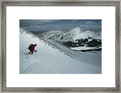 Skier Phil Atkinson Begins His Descent Framed Print by Tim Laman