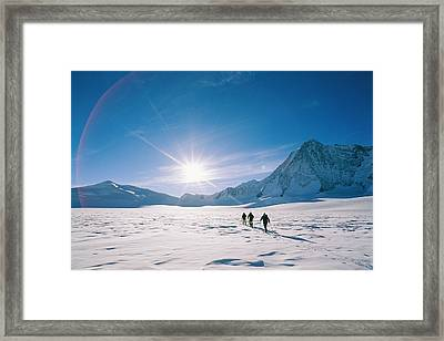 Skiers Approaching Mount Tyree Framed Print by Gordon Wiltsie