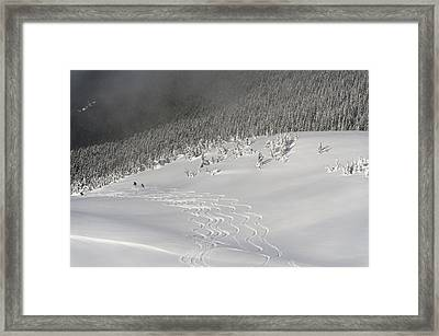 Skiers At The Base Of A Mountain Framed Print by Keith Levit