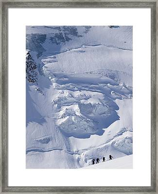 Skiers Cross The Aletsch Glacier En Framed Print by Axiom Photographic