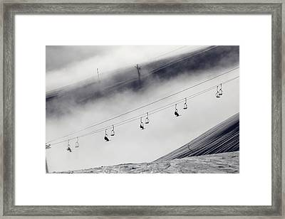 Skiers On A Chair Lift Framed Print