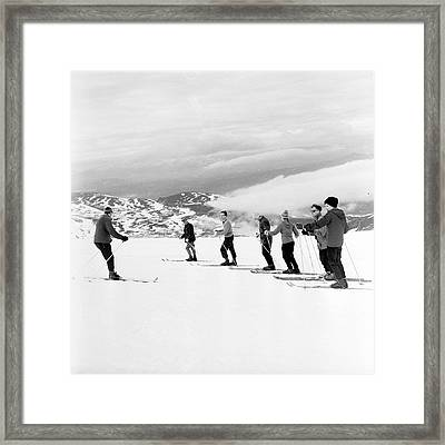 Skiing Lesson Framed Print by John Drysdale