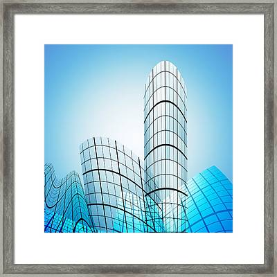 Skyscrapers In The City Framed Print by Setsiri Silapasuwanchai
