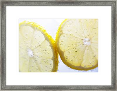 Slices Of Lemon In Sparking Water Framed Print by Louise Geoghegan