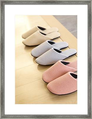 Slippers In A Row Framed Print by QxQ IMAGES/Datacraft
