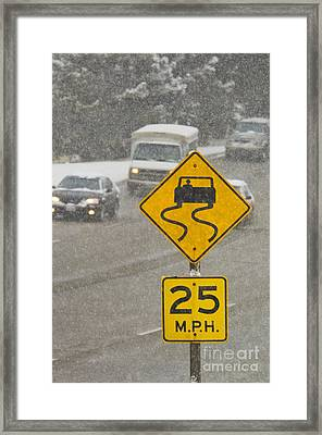 Slippery When Wet Road Sign Framed Print by Thom Gourley/Flatbread Images, LLC