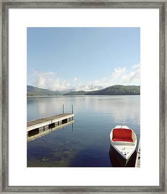 Small Boat Tied Up On Dock At Lake Placid. Framed Print