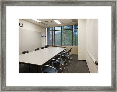 Small Empty Boardroom With A Long Framed Print by Marlene Ford