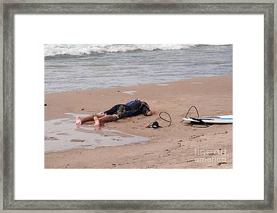 Small Surfer Lying On Beach Framed Print by Christopher Purcell