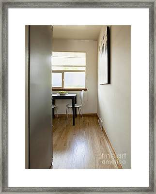 Small Table In A Sparse Room Framed Print by Inti St. Clair
