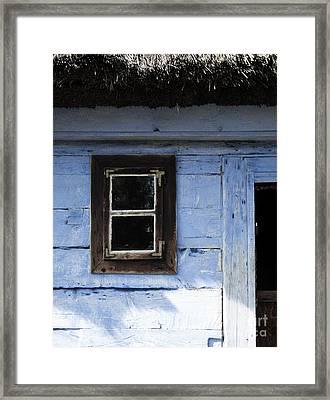 Small Window On Blue Wall Framed Print