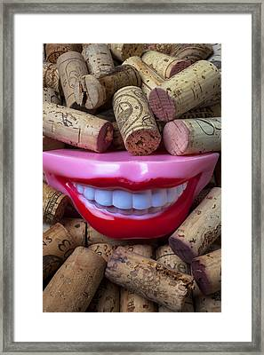 Smile Among Wine Corks Framed Print by Garry Gay