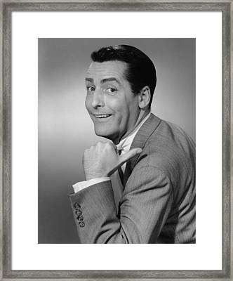 Smiling Man Pointing In Studio, (b&w), Portrait Framed Print