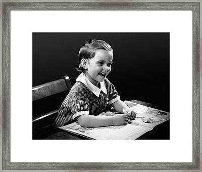 Smiling Young Girl Reading Book Framed Print by George Marks
