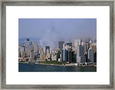 Smoke From The Ruins Of The World Trade Framed Print by Everett