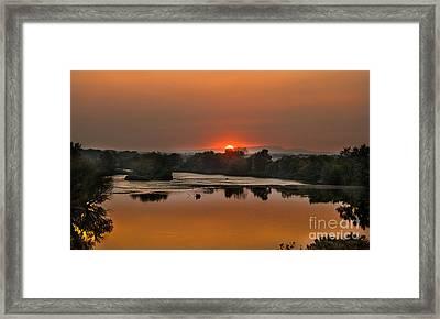 Smokey Sunset On The Payyett River Framed Print by Robert Bales