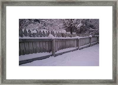 Snow Along A Fence Framed Print by Jeannette Brown