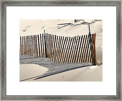 Snow Fence Shadows Framed Print by Richard Gregurich