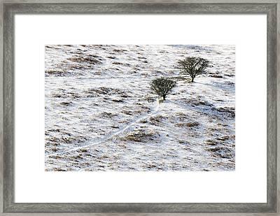 Snow On Moorland Framed Print by Adrian Bicker