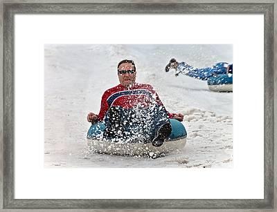 Snow Tubes Framed Print by Susan Leggett