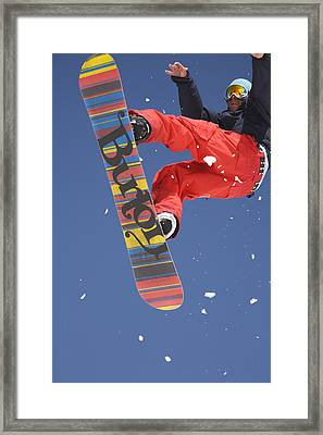 Snowboard Jumping On Vogel Mountain Framed Print by Ian Middleton